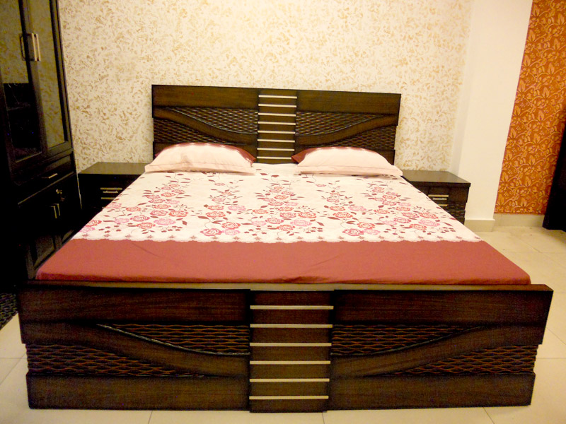 Wooden double beds wooden furniture store in kirti nagar for Latest model bed design